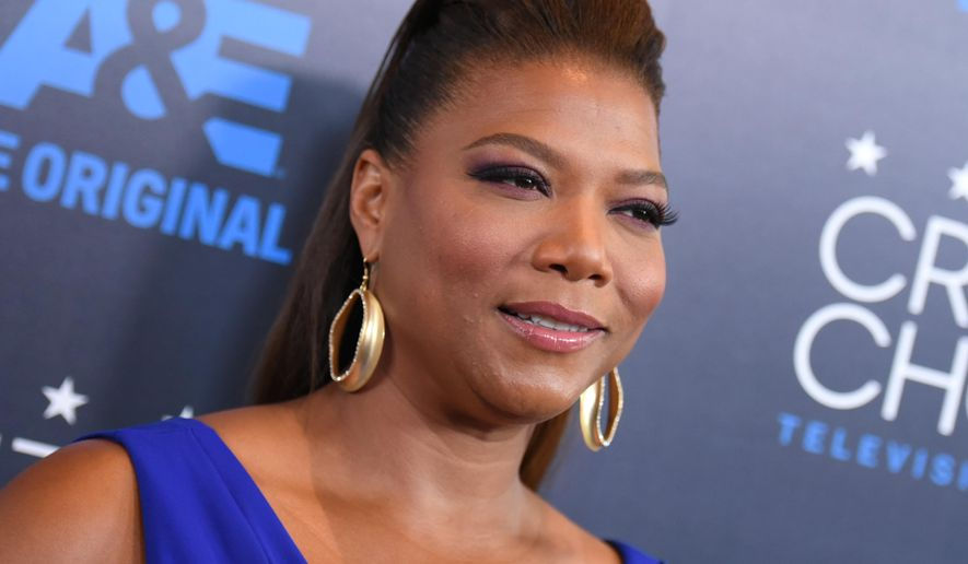 FILE - In this May 31, 2015, file photo, Queen Latifah arrives at the Critics' Choice Television Awards at the Beverly Hilton hotel in Beverly Hills, Calif. Latifah, Amy Schumer and Sara Evans headlined the first annual 4th of July Freedom Festival at the Intrepid Sea, Air & Space Museum in New York City on Saturday,  July 4, 2015. (Photo by Richard Shotwell/Invision/AP, File)