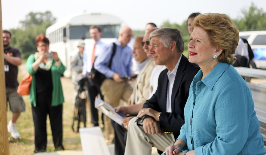 Sen. Debbie Stabenow, right, and Rep. Fred Upton look on during a tour of Fort Custer in Battle Creek, Mich., Monday, July 6, 2015. (Daytona Niles/Kalamazoo Gazette-MLive Media Group via AP) ALL LOCAL TELEVISION OUT; LOCAL TELEVISION INTERNET OUT; MANDATORY CREDIT