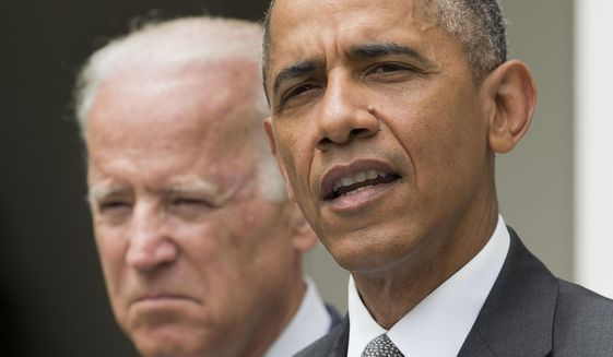President Obama and Vice President Joe Biden in the Rose Garden of the White House (Associated Press) **FILE**