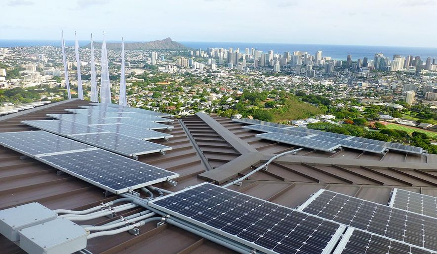 In this undated photo provided by Blue Planet Energy Systems, LLC, PV panels are on Henk Rogers' home in Honolulu. Rogers hopes the technology he is using in his home can help make other homes across Hawaii, and the world, energy independent as well. (Ryno Irwin/Blue Planet Energy Systems, LLC via AP)