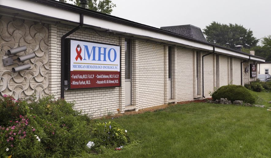 This Aug. 12, 2013 file photo shows the office of Dr. Farid Fata in Oak Park, Mich. The Detroit-area cancer specialist who fleeced insurance companies and gave unnecessary treatments to hundreds of patients, pleaded guilty last fall to fraud, money laundering and conspiracy. (AP Photo/Carlos Osorio, File)
