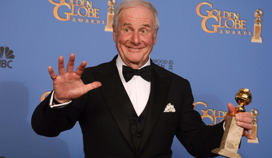 "FILE - In this Jan. 12, 2014 file photo, producer Jerry Weintraub poses in the press room with the award for best mini-series or motion picture made for television for ""Behind the Candelabra"" at the 71st annual Golden Globe Awards in Beverly Hills, Calif.  Weintraub, the dynamic producer and manager who pushed the career of John Denver and produced such hit movies as ""Nashville"" and ""Ocean's Eleven,"" died, Monday, July 6, 2015, of cardiac arrest in Santa Barbara, Calif. He was 77. (Photo by Jordan Strauss/Invision/AP, File)"