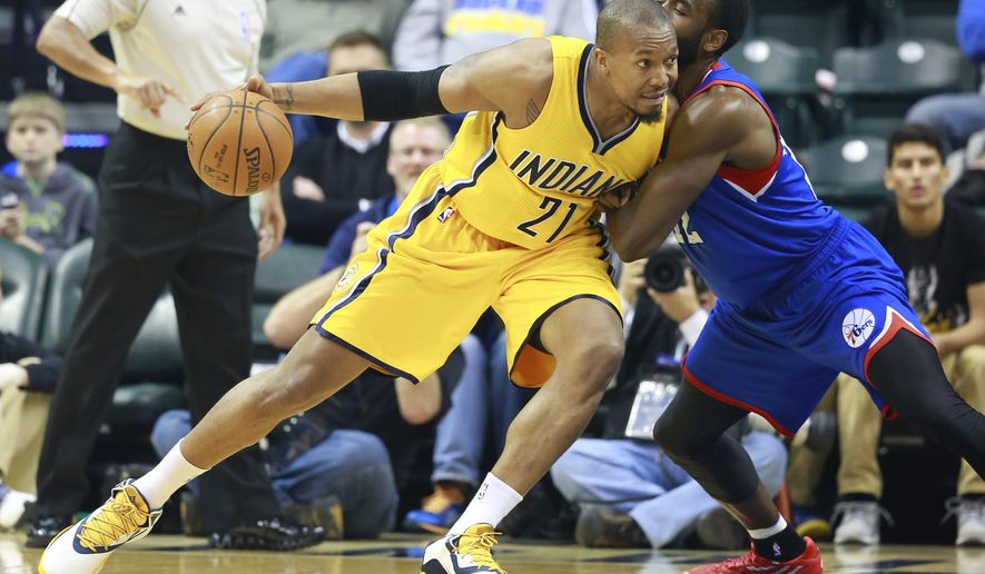 FILE - In this March 1, 2015, file photo, Indiana Pacers forward David West, left, moves to the basket defended by Philadelphia 76ers forward Luc Mbah a Moute in the first half of an NBA basketball game in Indianapolis. West is still looking for a team after bypassing the $12.6 million he would have earned next season in Indiana.  (AP Photo/R Brent Smith)