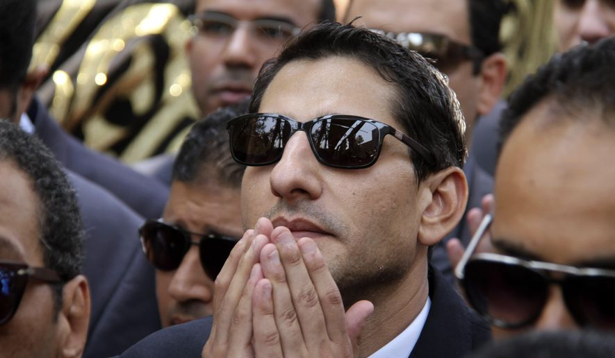 FILE - In this Tuesday, June 30, 2015 file photo, mourners, many from the judiciary, pray during the burial of slain Egyptian Prosecutor General Hisham Barakat, who was killed in a bomb attack a day earlier, at a cemetery in Cairo, Egypt. After a series of stunning militant attacks, including the assassination of Barakat, the government is pushing through a new controversial anti-terrorism draft bill. (AP Photo/Ahmed Gamil, File)