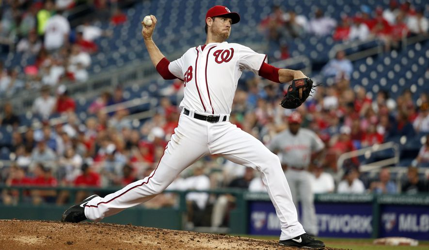 Washington Nationals starting pitcher Doug Fister (58) throws during the third inning of a baseball game against the Cincinnati Reds at Nationals Park, Monday, July 6, 2015, in Washington. (AP Photo/Alex Brandon)