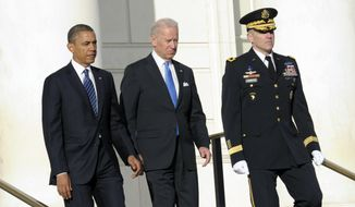 President Barack Obama and Vice President Joe Biden, accompanied by then-Maj. Gen. Michael S. Linnington, commander of the U.S. Army Military District of Washington, arrive to place a wreath at the Tomb of the Unknowns at Arlington National Cemetery in Arlington, Va. on Jan. 20, 2013. Mr. Linnington, the Pentagon's new leader of the search for military members missing from past wars, says he will push for more partnerships with private groups that have resources and interest in the MIA accounting mission. (AP Photo/Susan Walsh, File)