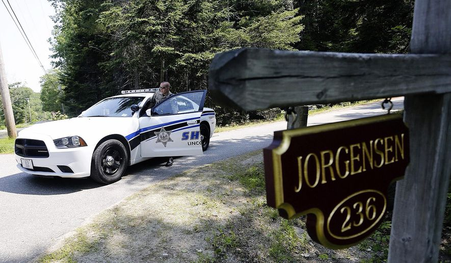 Lincoln County Deputy Ryan Chubbuck is stationed at the entrance to the Jorgensen residence on Lakeside Drive in Boothbay Harbor, Me., Sunday, July 5, 2015,following the discovery Saturday of three bodies at two residences in Boothbay Harbor. The bodies of Svend Jorgensen, 71, and his wife, Carol Jorgensen, 75, were discovered Saturday in their home on Lakeside Drive in Boothbay Harbor, Me. The body of their son, Eric Jorgensen, was found at his Montgomery Road home. (Derek Davis/Portland Press Herald via AP)