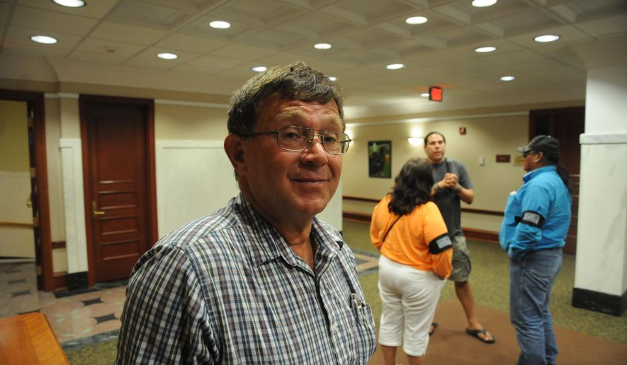 Buffalo resident Tom Wilson, who supports the Keystone XL pipeline, poses for a photo at a hearing of the South Dakota Public Utilities Commission at the state Capitol in Pierre, S.D., Monday, July 6, 2015. (AP Photo/James Nord)