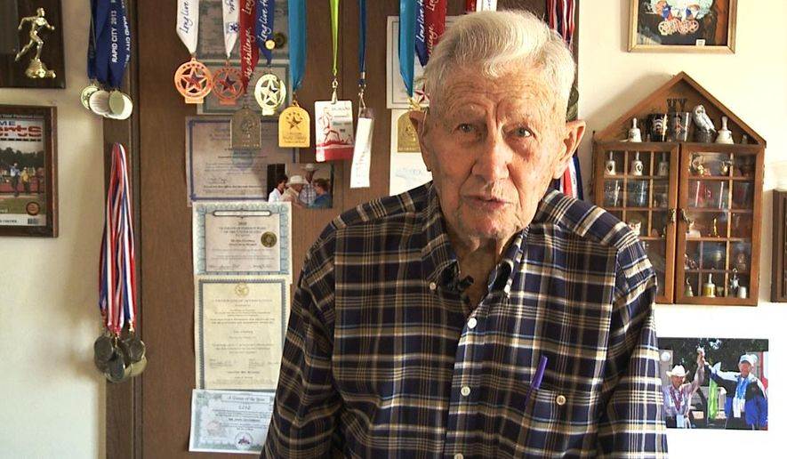 This Sunday, July 5, 2015, photo from video provided by KSFY-TV in Sioux Falls, S.D. shows centenarian John Zilverberg at home in Highmore, S.D. Zilverberg, who will turn 102 in August, will be taking part in this year's National Senior Games being held through July 15 in the Minneapolis area. He is the oldest athlete in the competition. (KSFY-TV via AP)