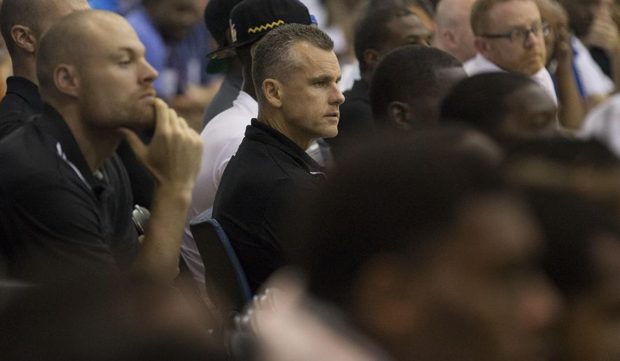 New head coach of the Oklahoma City Thunder Billy Donovan watches his team play against the Orlando Magic  during the second half of an NBA summer league basketball game in Orlando, Fla., Monday, July 6, 2015. (AP Photo/Willie J. Allen Jr.)