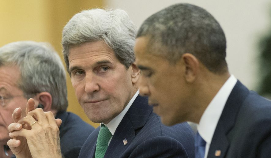 Secretary of State John F. Kerry speaks to President Obama prior to reaching a nuclear deal with Iran. (Associated Press) ** FILE **