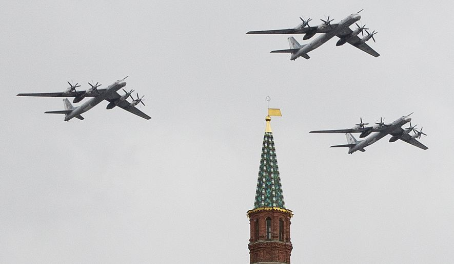 Russian Air Force strategic bombers fly in formation over Red Square on May 7, 2014, during a rehearsal for the Victory Day military parade two days later in Moscow. (Associated Press)