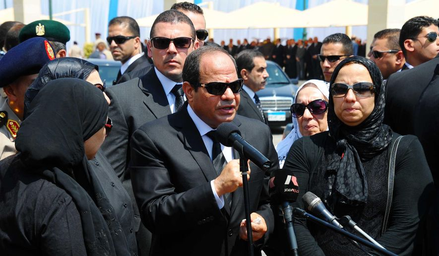 President Abdel-Fattah el-Sissi, center, speaks at the funeral of the top public prosecutor Hisham Barakat, killed in a terrorist attack, as he was surrounded by Barakat's family members in Cairo, Egypt. (Egyptian Presidency via AP, File)