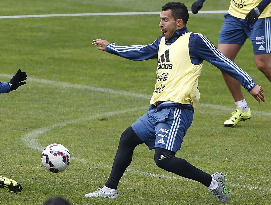 Argentina's Carlos Tevez winds up to kick a ball during a training session in Concepcion, Chile, Wednesday, July 1, 2015. Argentina defeated Paraguay 6-1 on Tuesday and will face Chile in the final of Copa America soccer tournament Saturday. (AP Photo/Andre Penner)