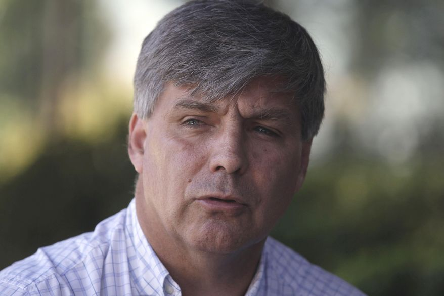"""FILE - In this Jan. 28, 2015, file photo, Harold Mayne-Nicholls, speaks during a news conference in Santiago, Chile. FIFA has banned the official it chose to inspect 2018 and 2022 World Cup hosting candidates for breaking ethics rules. FIFA says Harold Mayne-Nicholls of Chile is barred from """"any kind of football-related activity at national and international level"""" for seven years. (AP Photo/Luis Hidalgo, File)"""