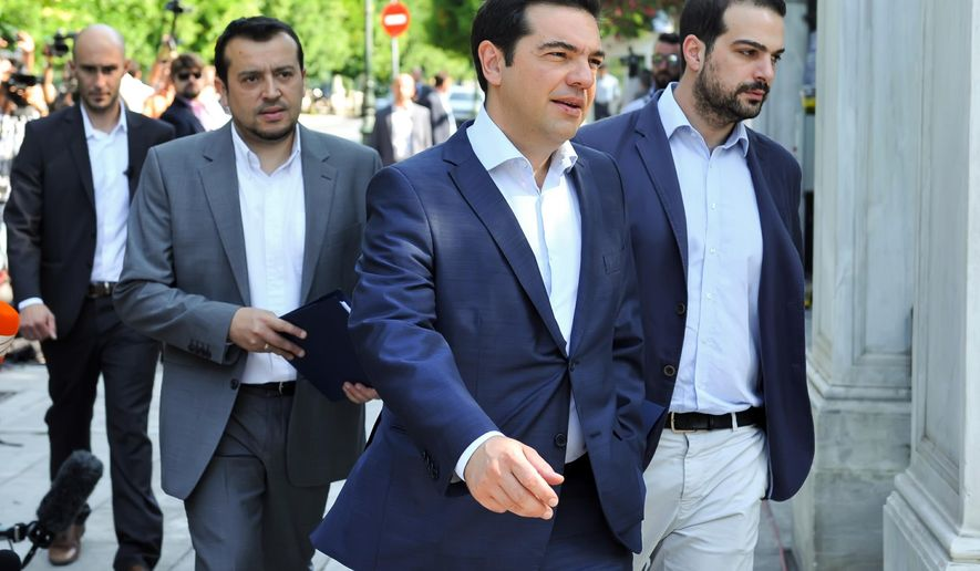 Greek Prime Minister Alexis Tsipras, center,  arrives to attend a meeting with Greek political party leaders at the Presidential Palace as Minister of State Nikos Pappas, left, and Government spokesman Gabriel Sakellaridis, right, follow him in Athens, Monday, July 6, 2015. Greek Finance Minister Yanis Varoufakis resigned Monday, saying he was told shortly after Greece's decisive referendum result that some other eurozone finance ministers and the country's other creditors would appreciate his not attending the ministers' meetings.(Giannis Kotsiaris/InTime News via AP) GREECE OUT