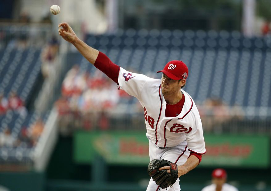 Washington Nationals starting pitcher Doug Fister (58) throws during the first inning of a baseball game against the Cincinnati Reds at Nationals Park, Monday, July 6, 2015, in Washington. (AP Photo/Alex Brandon)