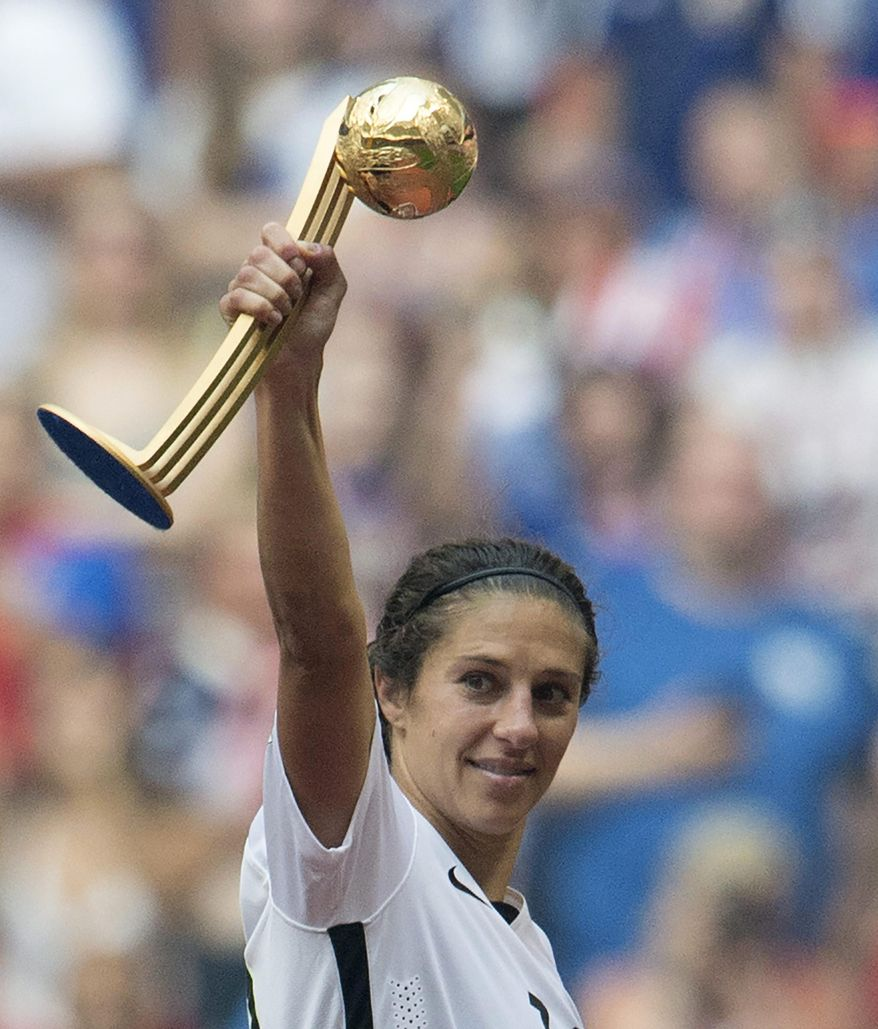 United States' Carli Lloyd holds the trophy after they defeated Japan 5-2 in the FIFA Women's World Cup soccer championship in Vancouver, British Columbia, Canada, Sunday, July 5, 2015. (Jonathan Hayward/The Canadian Press via AP) MANDATORY CREDIT