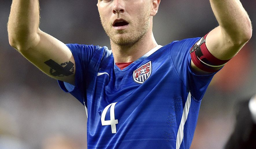 FILE - In this June 10, 2015, file photo, United States' Michael Bradley celebrates after a friendly match against Germany in Cologne, Germany. Bradley's plays his 100th game with the U.S. men's national team in the CONCACAF Gold Cup opener against Honduras on Tuesday, July 7, 2015, in Dallas. (AP Photo/Martin Meissner, File)