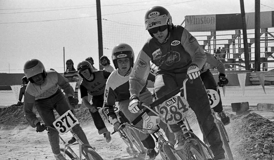 In this 1976 photo provided by USA BMX, Scot Breithaupt leads the pack in a BMX bicycle race in Las Vegas. Scot Alexander Breithaupt, who organized bicycle races on dirt motorcycle courses in the early 1970s, becoming a founder of BMX and later a champion and one of the cycling sport's best known figures, died in Indio, Calif., authorities said Monday, July 6, 2015.  (Courtesy Russ Okawa Archives/USA BMX via AP)