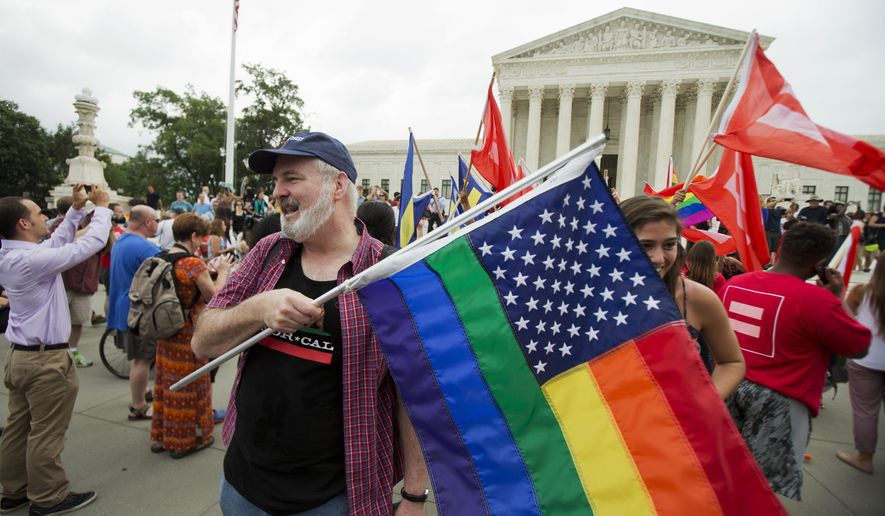 Supporters of same-sex marriage celebrate outside the Supreme Court in Washington, Friday, June 26, 2015 after the court declared that same-sex couples have a right to marry anywhere in the United States. It was 2004 when Massachusetts became the first state to allow same-sex couples to marry. Eleven years later, the Supreme Court has now ruled that state marriage laws must fall if they do not permit same-sex couples to marry. (AP Photo/Manuel Balce Ceneta)