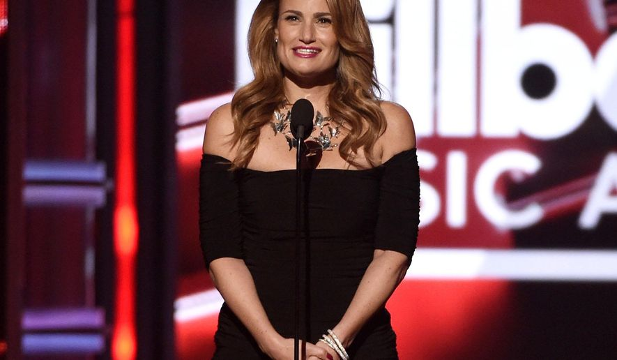 FILE - In this May 17, 2015 file photo, Idina Menzel introduces a performance by Mariah Carey at the Billboard Music Awards in Las Vegas, Nev. Menzel, 44, will kick off a North American tour Tuesday, July 7, in Richmond, Va. She will play nearly 40 shows, visiting Philadelphia, Houston, Atlanta, Chicago and Washington, DC. (Photo by Chris Pizzello/Invision/AP, File)