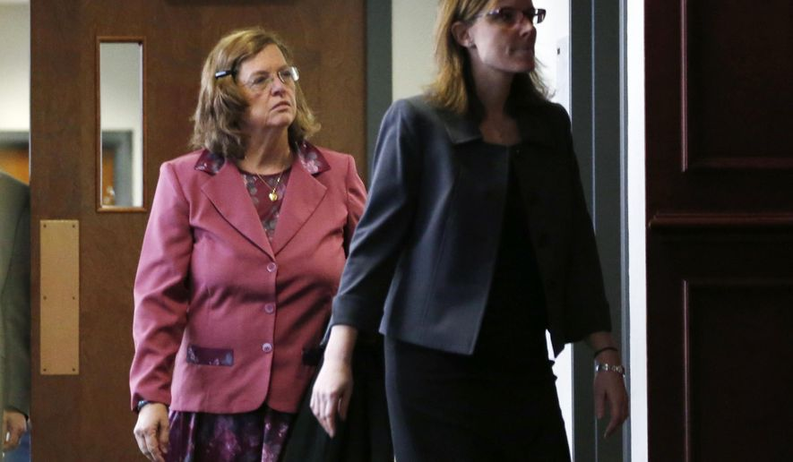 FILE - In this Dec. 8, 2014 file photo, Arlene Holmes, left, mother of James Holmes who is charged in the killing of 12 moviegoers and the wounding of 70 others in a shooting spree in a crowded theatre in Aurroa, Colo., on July 20, 2012, leaves the courtroom after a pre-trial readiness hearing in Centennial, Colo., in the murder trial of her son. After more than two months of testimony in the trial, new details have been revealed to show the strained relationship that had developed between Holmes, his parents and sister leading up to the massacre in the theatre.  (AP Photo/David Zalubowski, File