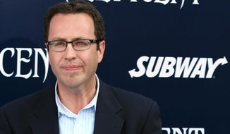 "In this May 28, 2014 photo, Subway restaurant spokesman Jared Fogle arrives at the world premiere of ""Maleficent"" at the El Capitan Theatre in Los Angeles. FBI agents and Indiana State Police raided Fogle's Zionsville, Ind. home on Tuesday, July 7, 2015, removing electronics from the property and searching the house with a police dog. (Photo by Matt Sayles/Invision/AP)"