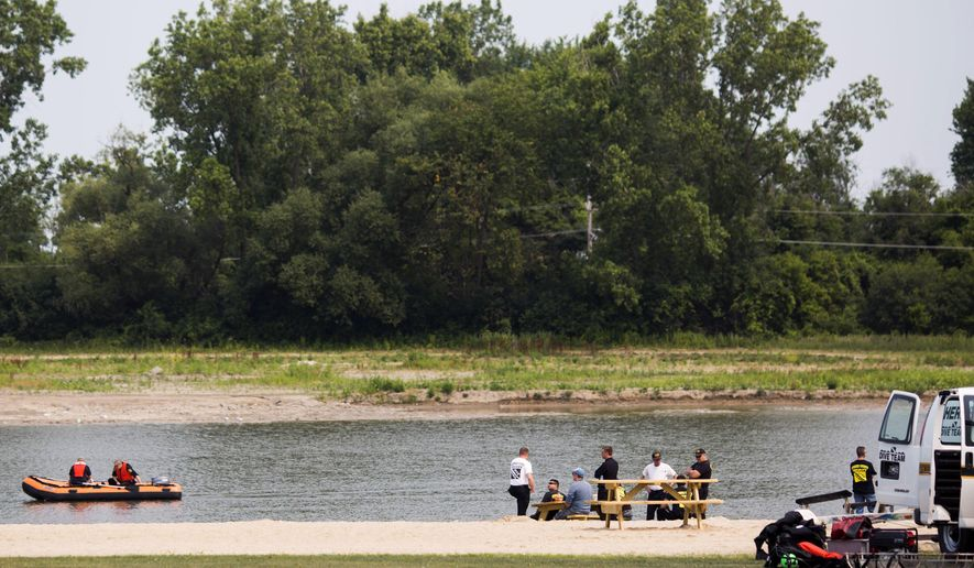 Authorities search Lake Callis for Omarion Humphrey, who was reported missing in Davison Township, Mich., Sunday July 5, 2015. (Christian Randolph/The Flint Journal-MLive.com via AP)