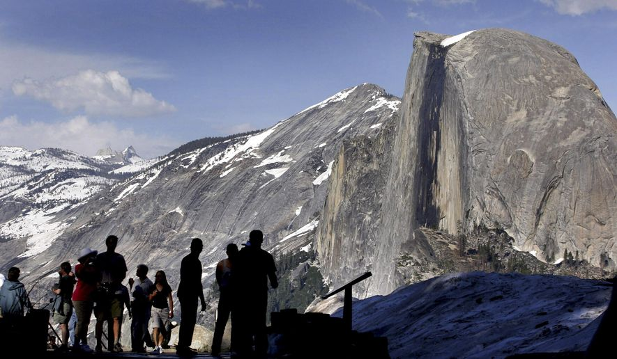 FILE - In this 2005 file photo, visitors view Half Dome from Glacier Point at Yosemite National Park, Calif. A massive sheet of rock has fallen from the vertical face of Half Dome in Yosemite National Park, making one of the most popular routes attempted by climbers in North America even more challenging, park officials said Tuesday, July 7, 2015. (AP Photo/Dino Vournas, File)