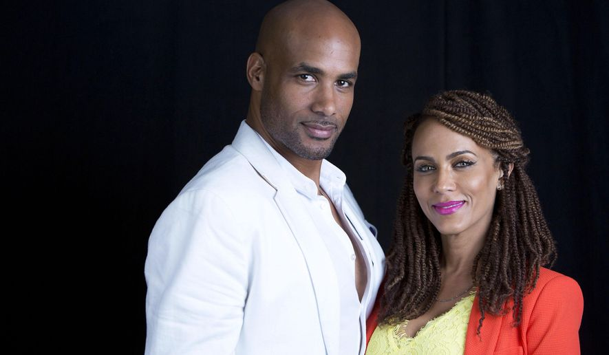 """FILE - In this June 15, 2015 file photo, actor Boris Kodjoe poses for a portrait with his actress wife Nicole Ari Parker to promote their upcoming talk show """"The Boris and Nicole Show"""" in New York.  The show will air in a test run beginning July 6 for four weeks on select Fox stations. (Photo by Amy Sussman/Invision/AP, File)"""
