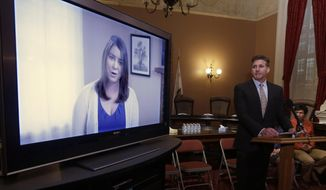 In this March 25, 2015 file photo, Dan Diaz, the husband of Brittany Maynard, watches a video of his wife, recorded 19 days before her assisted suicide death, where she says that no one should have to leave their home to legally end her life, during a news conference at the Capitol in Sacramento, Calif. The authors of a bill that would allow California physicians  to help terminally ill patents end their lives, Sen. Lois Wolk, D-Davis and Sen. Bill Monning, D-Carmel, did not present the measure to the Assembly Health Committee as scheduled because it did not have enough votes to advance, Tuesday, July 7, 2015.  Maynard, a 29-year-old San Francisco woman who had terminal brain cancer, moved to Oregon where she could legally end her life.  (AP Photo/Rich Pedroncelli, File)
