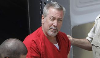 In this May 8, 2009, file photo, former Bolingbrook, Ill., police Sgt. Drew Peterson arrives for court in Joliet, Ill. On Tuesday, July 7, 2015, Peterson is due back in court in Chester, Ill., as his trial on charges of plotting to kill a prosecutor approaches. Peterson has pleaded not guilty to charges of soliciting an unidentified prison inmate to kill Will County State's Attorney James Glasgow. (AP Photo/M. Spencer Green, File)