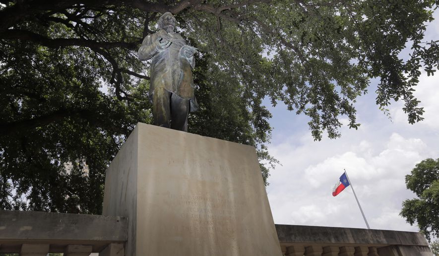 A statue of Jefferson Davis stands on the Texas campus, Tuesday, July 7, 2015, in Austin, Texas. As University of Texas administrators consider a request to remove the statue that symbolizes the Confederacy, the number of memorials in Texas honoring the Confederate cause and its leaders continues to grow. (AP Photo/Eric Gay)