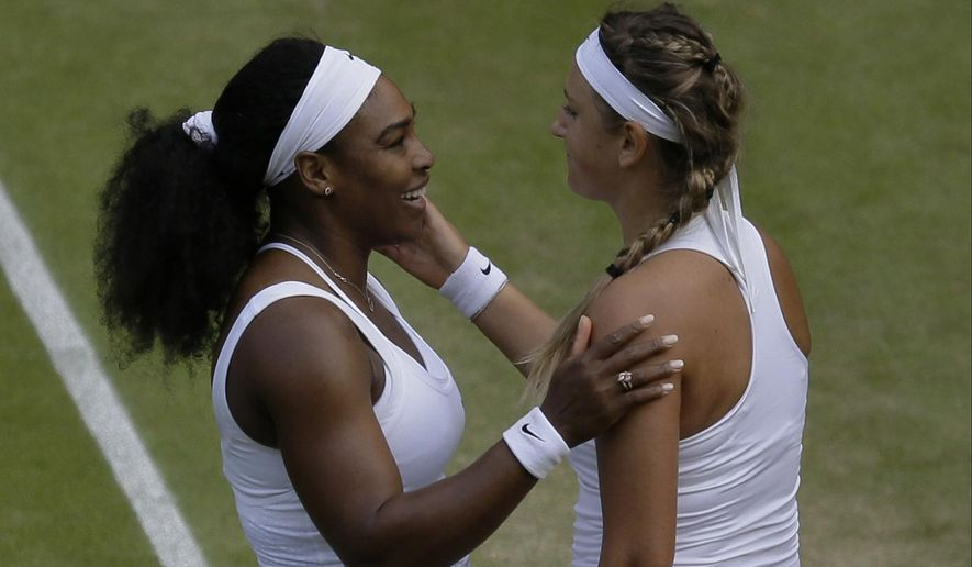 Serena Williams of the United States talks to Victoria Azarenka of Belarus, after defeating her in their singles match, at the All England Lawn Tennis Championships in Wimbledon, London, Tuesday July 7, 2015. Williams won 3-6, 6-2, 6-3.  (AP Photo/Pavel Golovkin)