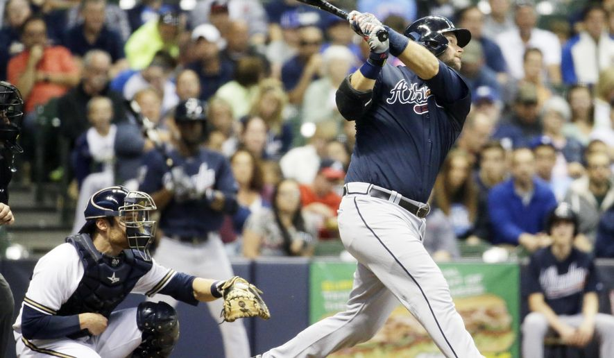 Atlanta Braves' A.J. Pierzynski hits an RBI single during the fourth inning of a baseball game against the Milwaukee Brewers Tuesday, July 7, 2015, in Milwaukee. (AP Photo/Morry Gash)