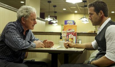 "This photo provided by Gramercy Pictures shows, Victor Garber, left, as Martin, and Ryan Reynolds as Young Damian in Gramercy Pictures' psychological science fiction thriller ""Self/less,"" directed by Tarsem Singh and written by Alex Pastor and David Pastor.  (Hilary Bronwyn Gayle/Gramercy Pictures via AP)"