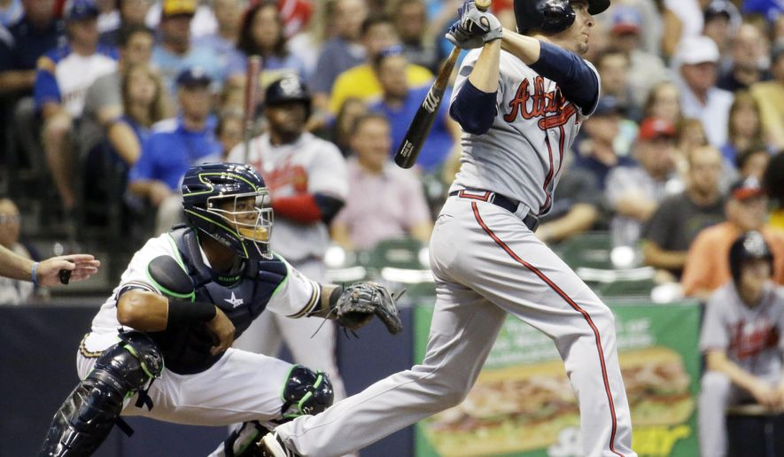 Atlanta Braves' Kelly Johnson hits an RBI single during the second inning of a baseball game against the Milwaukee Brewers Monday, July 6, 2015, in Milwaukee. (AP Photo/Morry Gash)