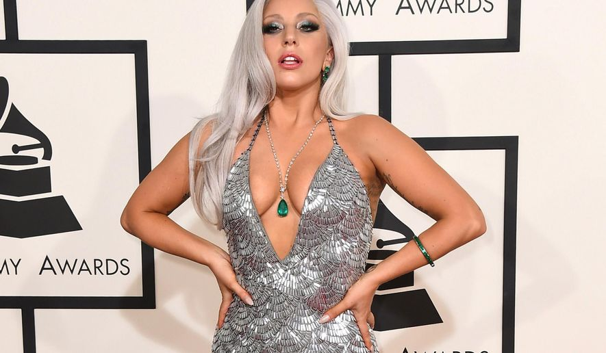 FILE - In this Feb. 8, 2015 file photo, Lady Gaga arrives at the 57th annual Grammy Awards at the Staples Center in Los Angeles. Brandon Maxwell, Lady Gaga's longtime stylist and a designer in his own right, plans to show his first full ready-to-wear collection at New York Fashion Week in September. Maxwell has created numerous looks for Gaga over the years, including a silver gown with a plunging neckline and high slit for this year's Grammys and a majority of the outfits she has worn for her Cheek to Cheek tour with Tony Bennett. (Photo by Jordan Strauss/Invision/AP, File)