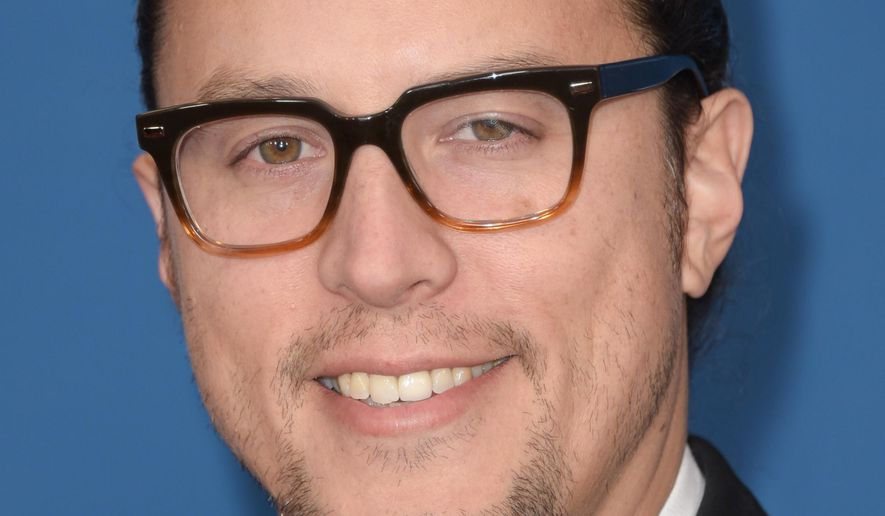 "FILE - In this Feb. 7, 2015 file photo, Cary Fukunaga arrives the 67th Annual DGA Awards in Los Angeles. Netflix's upcoming slate of original films will begin rolling out with Fukunaga's ""Beasts of No Nation"" in October and Adam Sandler's ""The Ridiculous Six"" in December. The streaming network announced release plans for four movies on Tuesday, July 7, 2015, laying out the schedule for its high-profile push into original films. (Photo by Richard Shotwell/Invision/AP, File)"