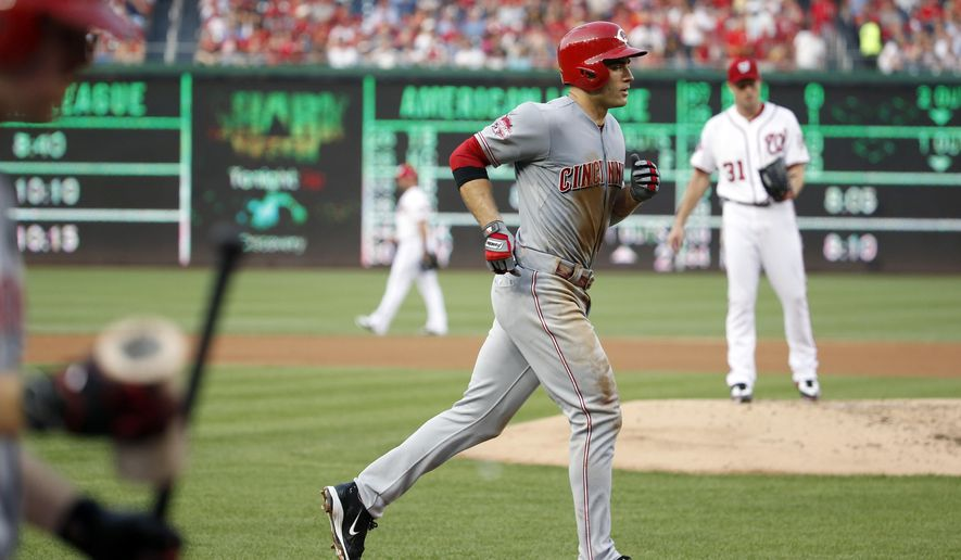 Cincinnati Reds' Joey Votto runs the bases on a solo home run as Washington Nationals starting pitcher Max Scherzer (31) stands on the mound during the third inning of a baseball game at Nationals Park, Tuesday, July 7, 2015, in Washington. (AP Photo/Alex Brandon)