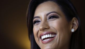 In this Monday, July 6, 2015 photo, Miss California Natasha Martinez speaks during an interview after rehearsals for the upcoming Miss USA Pageant in Baton Rouge, La. Pageant co-owner Donald Trump recently made comments painting Mexican immigrants as criminals. (AP Photo/Gerald Herbert)