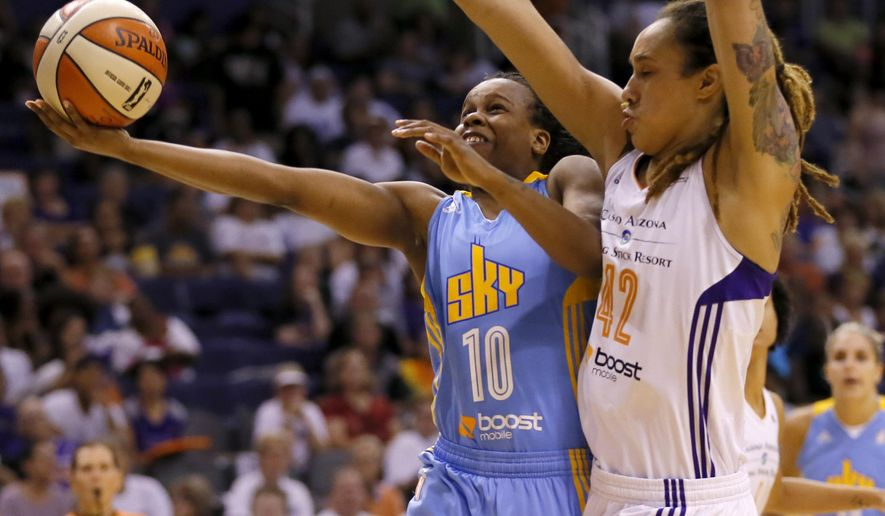 FILE - In this Sept. 9, 2014, file photo, Phoenix Mercury center Brittney Griner (42) defends as Chicago Sky guard Epiphanny Prince (10) shoots during the second half of  Game 2 of the WNBA basketball finals in Phoenix. Prince will finally get to play for her hometown team, the New York Liberty, on Thursday, July 9, 2015. (AP Photo/Matt York, File)