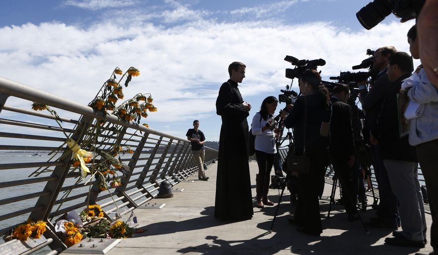 Father Cameron Faller, of Restorative Justice Ministry, answers questions before a vigil for Kathryn Steinle, Monday, July 6, 2015, on Pier 14 in San Francisco. Steinle was shot and killed on Wednesday, July 1st on Pier 14. Francisco Sanchez was arrested for the shooting. (AP Photo/Beck Diefenbach)