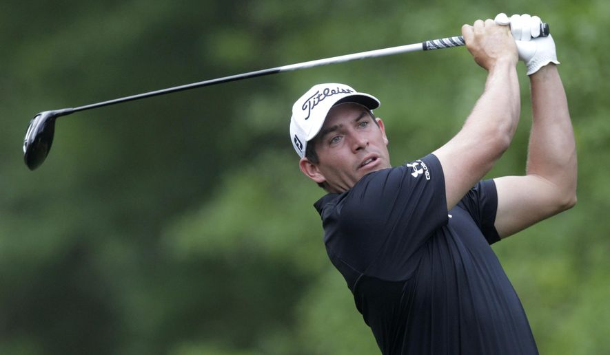 FILE - In an April 2, 2015, file photo Scott Stallings watches his tee shot on the second hole at the Houston Open golf tournament in Humble, Texas.  Stallings has been suspended for three months for violating the PGA Tour's anti-doping policy.(AP Photo/Patric Schneider, file)