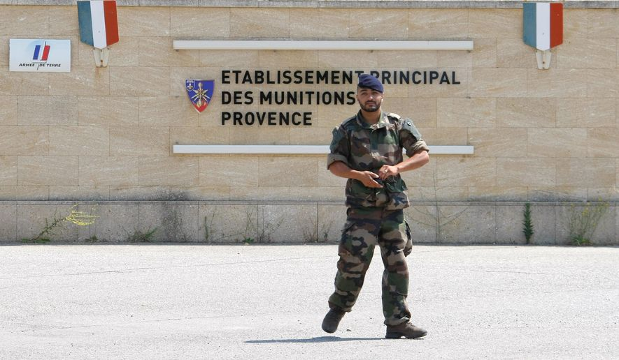 A soldier walks outside the weapons stocks military base in Miramas , southern France, Tuesday, July 7, 2015.  French authorities are investigating the theft of roughly 200 detonators plus grenades and plastic explosives from the military site.  The break-in comes as France has strengthened its security measures after two deadly attacks by extremists this year. (AP Photo/Claude Paris) ** FILE **