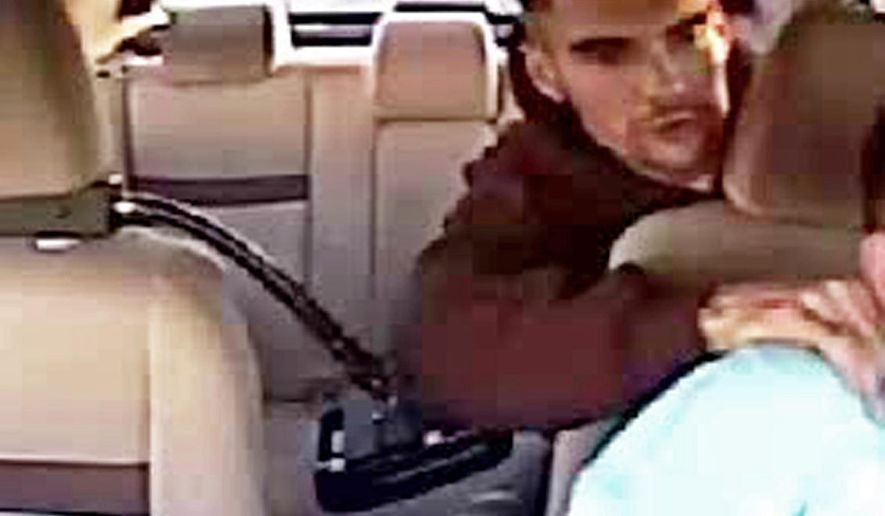 In this May 8, 2015 still frame from surveillance video provided by the Las Vegas Metropolitan Police Department, a man robs a Las Vegas cab driver. Police are seeking the man who held something sharp to the cab driver's rib cage and demanded cash and the driver's cell phone. (Las Vegas Metropolitan Police Department via AP)
