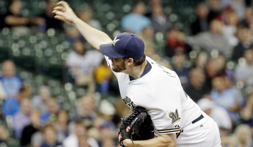 Milwaukee Brewers starting pitcher Tyler Cravy throws during the first inning of a baseball game against the Atlanta Braves Tuesday, July 7, 2015, in Milwaukee. (AP Photo/Morry Gash)