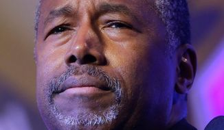 """""""The tax pledge is the least I can do,"""" Republican presidential candidate Ben Carson said. """"I would go much further than saying I am not going to raise taxes."""" (Associated Press)"""