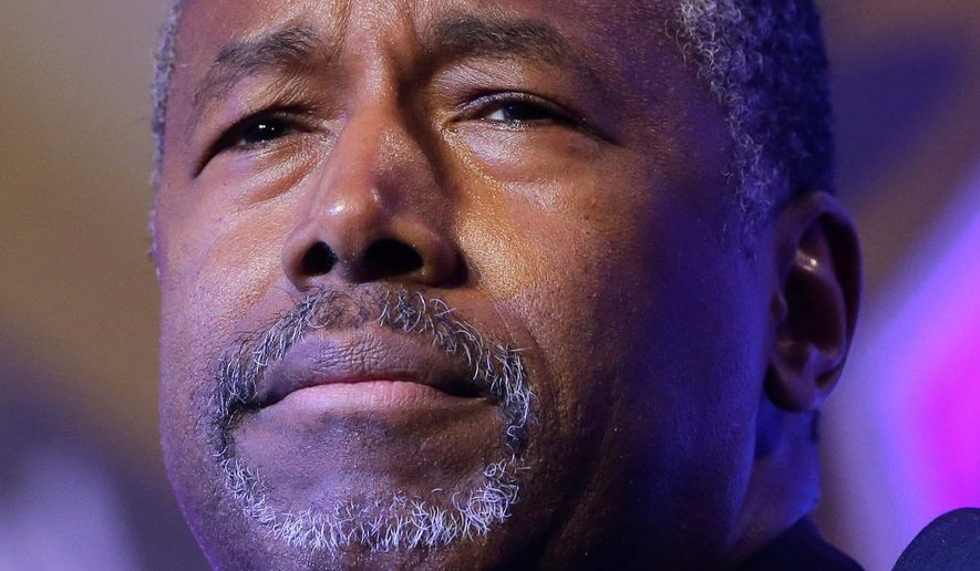"""The tax pledge is the least I can do,"" Republican presidential candidate Ben Carson said. ""I would go much further than saying I am not going to raise taxes."" (Associated Press)"